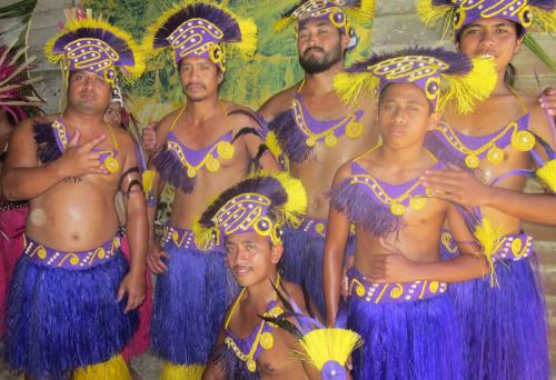 Kimiangatau men in their Ura Pau costume