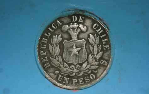 A 19th century Chilean coin embedded in the pulpit of the Divided Church