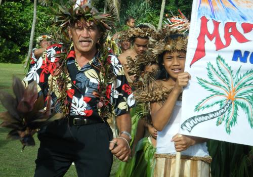 Samuela Ariki leading his people on Mauke Day