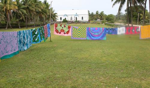 Women's group show of textiles in front of the Divided Church